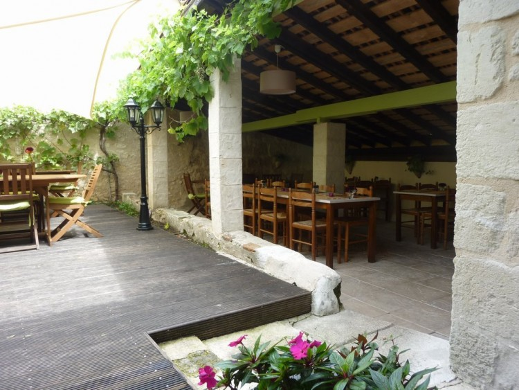 Property for Sale in 4 apartments in a former 11th century pilgrim hospital with restaurant, Charente, Near Aubeterre-sur-Dronne, Charente, Nouvelle-Aquitaine, France
