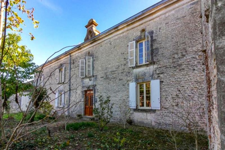 Property for Sale in Very attractive group of buildings in the heart of a village close to Jarnac, Charente, Nouvelle-Aquitaine, France