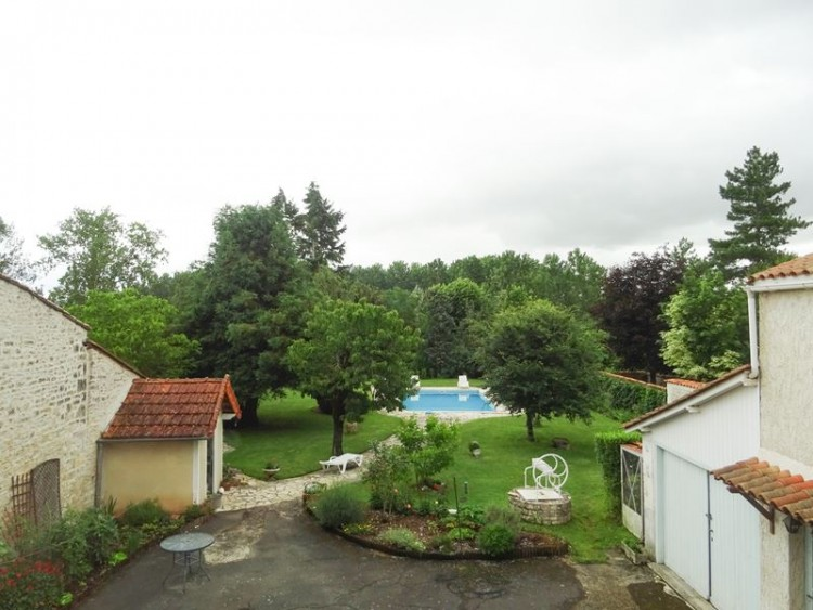 Property for Sale in Pretty town house with 2 apartments, a pool and a riverside garden, Charente, Nouvelle-Aquitaine, France