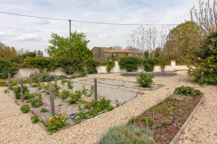 Property for Sale in VIRTUAL VIEWING AVAILABLE - Spacious country property with pretty garden and outbuildings, Charente, Nouvelle-Aquitaine, France