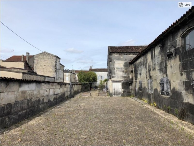 Property for Sale in Beautiful Charentaise townhouse with walled garden and heated swimming pool, Charente, Nouvelle-Aquitaine, France