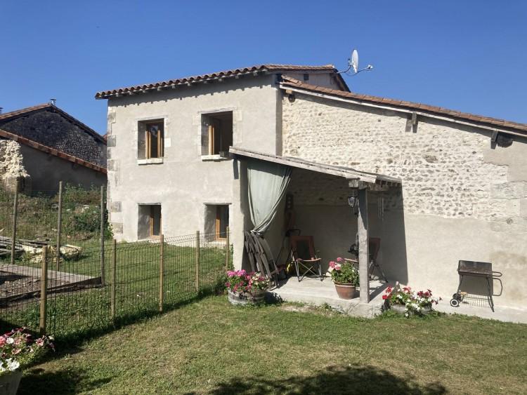 Property for Sale in Renovated house centre village, Charente, Near Aubeterre-sur-Dronne, Charente, Nouvelle-Aquitaine, France