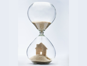 Sand timer that is building a house