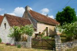 Romantic old  French house with white roses