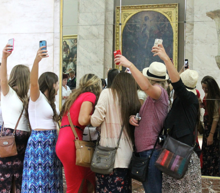 People taking selfies in a museum
