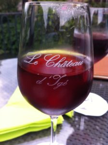 Apéritif time at Château d'Igé! - A glass of red wine