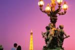 Couple look at Alexander 3rd Bridge and Eiffel Tower Paris France