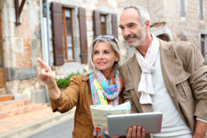 A couple planning their property inspection trip to France