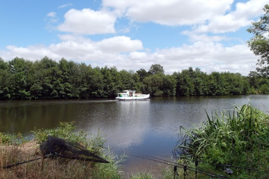 Carp fishing lake and boat in France