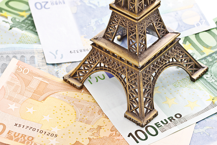 Eiffel tower model with Euro banknotes