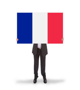 French resident holding up the french flag in his face