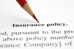 Close up of pen on insurance policy** Note: Shallow depth of field