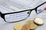 Euro coins in top of a french tax document