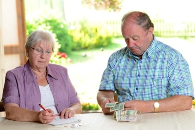 older couple calculating her little budget