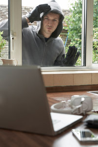 Holiday home security: top tips-window
