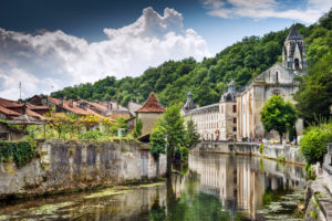 The Abbey of Brantôme stands over the River Dordogne; the picturesque medieval town of Sarlat is a major tourist attraction The Abbey of Brantôme stands over the River Dordogne; the picturesque medieval town of Sarlat is a major tourist attraction