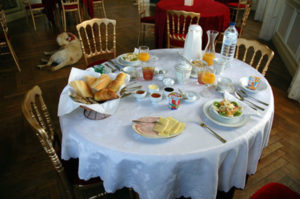 a breakfast table at chambre-d'hotes