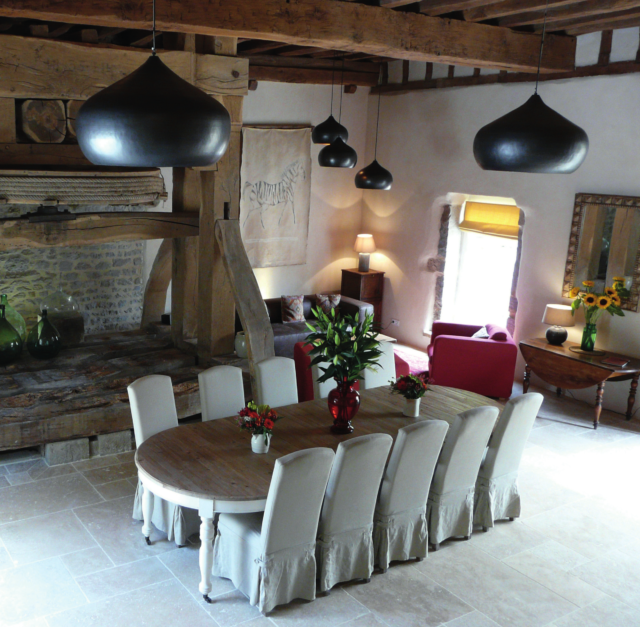 The dining hall in Burgundy property features an original 18th-century wine press