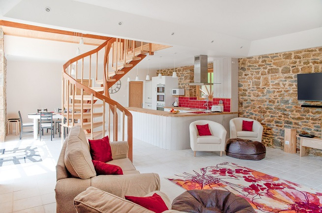 Open plan living space in the barn conversion in Brittany