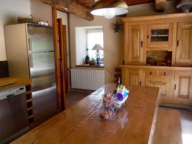Bespoke oak kitchen and large oak dining table and chairs in Le Deran, Brittany