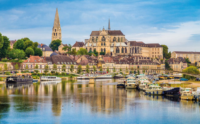 The Cathedral of Saint Étienne in Auxerre sits on the banks of the Yonne River