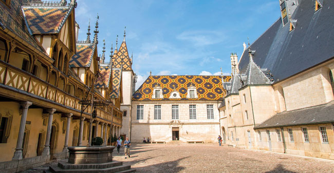 The medieval Hospices de Beaune displays the area's trademark roofs