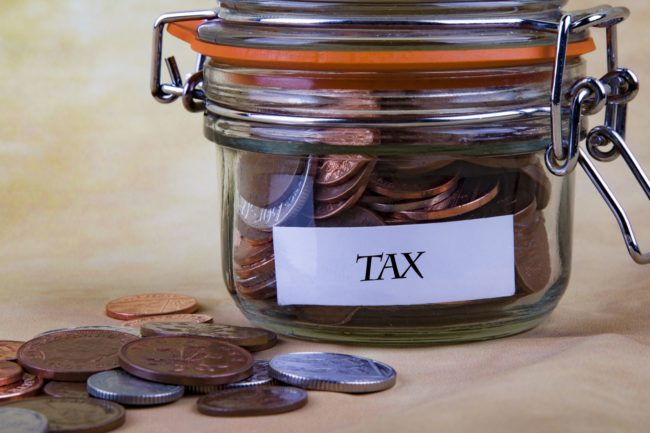 coins in a jar labelled tax