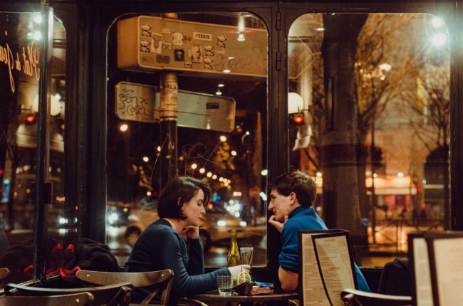 moving to France - couple in french restaurant