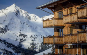 Chalet properties in front of snow mountains in France