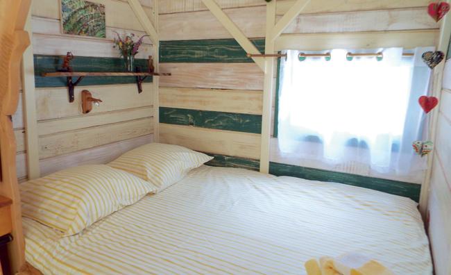 bedroom of cabin in the woods
