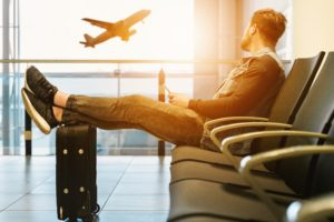 Man waiting at the airprot to represent currency exchange when travelling