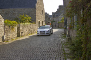 Driving in France down cobbled French street