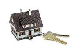 Small model house attached to keys as representation of buying a Property in France