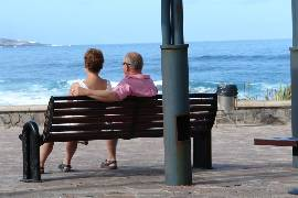 couple on a bench by the sea