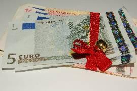 euro money on red ribbon