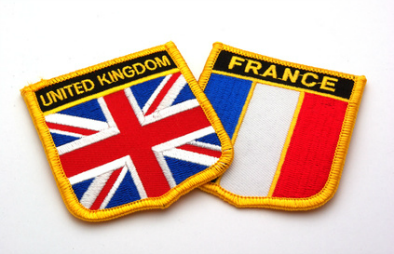 UK and French flags on a badge