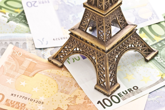 Euros under a Eiffel tower model