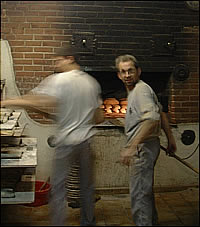 Men at oven