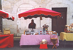 Sue at our market stall in Montcuq