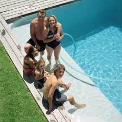 Family relaxing poolside