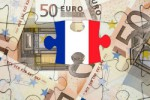 French tax due represented by a jigsaw puzzle of euros with one piece being the french flag