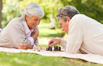 couple playing chess - retirement planning